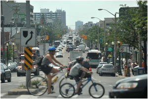 People biking along Eglinton corridor in Toronto