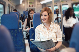 Woman sitting in GO Train