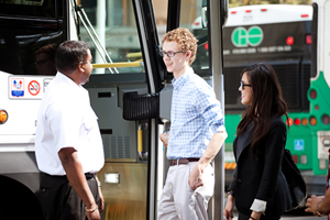 Passengers talking to a Metrolinx bus driver
